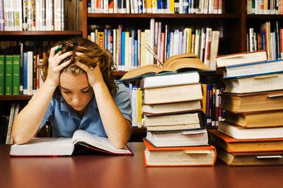 Teenage Student Studying Hard --- Image by © Randy Faris/Corbis